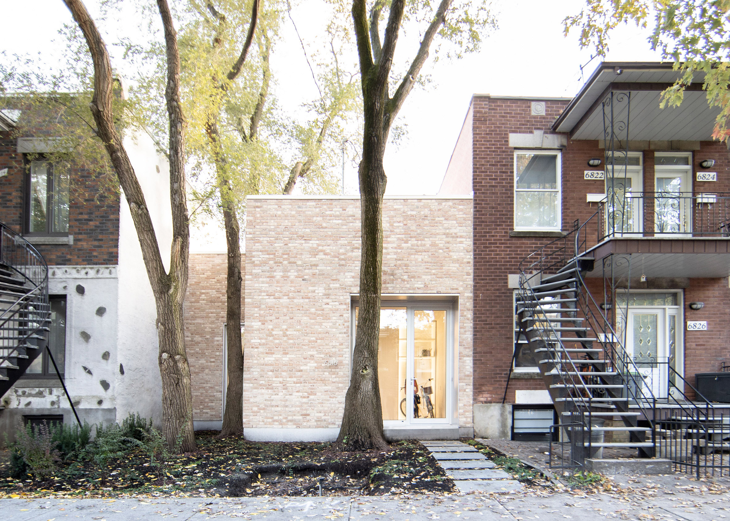"""TBA adds pale brick volume to traditional Montreal """"shoebox"""" home - This Is What We Are Reading For You"""