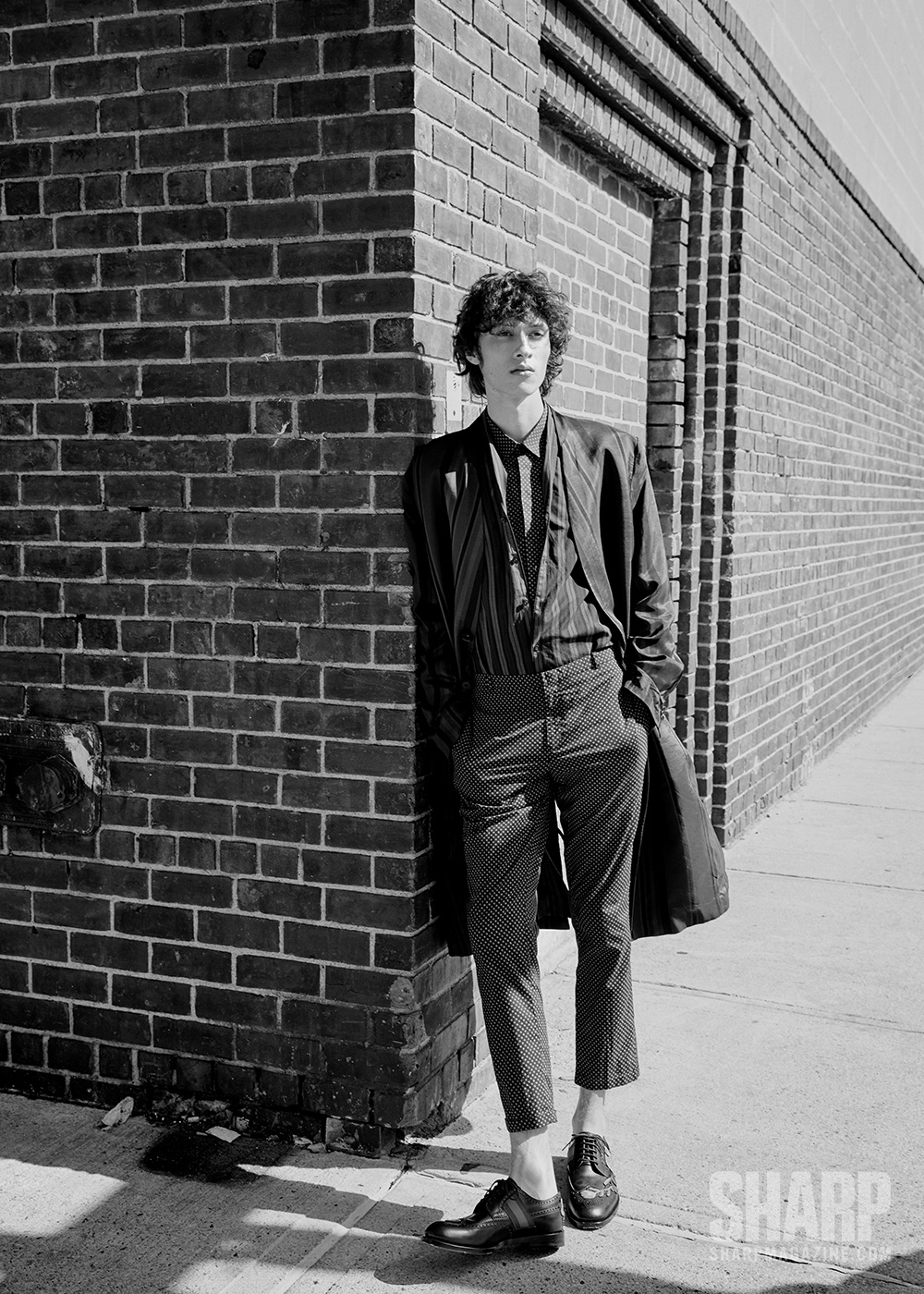 COTTON COAT (PRICE UPON REQUEST), COTTON SHIRT (PRICE UPON REQUEST), COTTON SHIRT (PRICE UPON REQUEST), AND COTTON PANTS (PRICE UPON REQUEST) BY THE KOOPLES; LEATHER SHOES ($1,495) BY GUCCI.